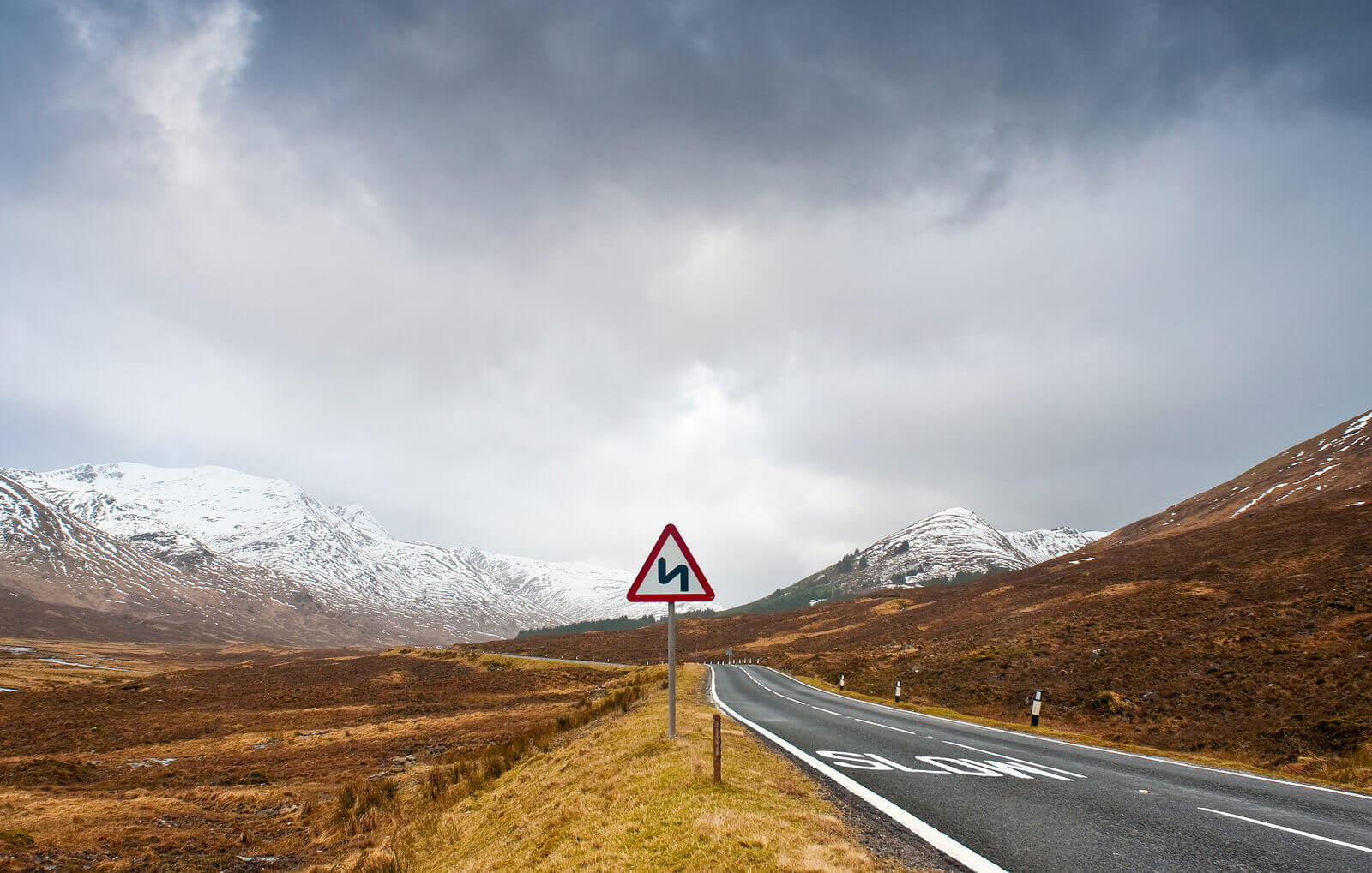 A82 road heading into Scottish mountains and highland countryside, perfect scenic route