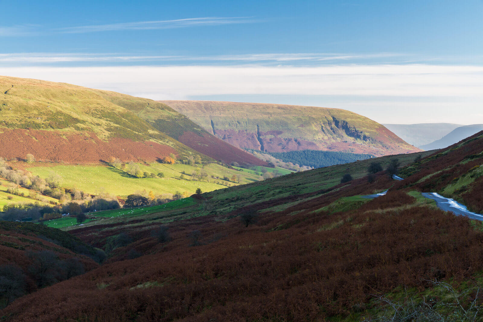 A4069 road in Wales, stunning view of green mountainside on sunny day