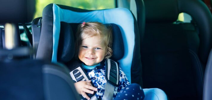 Adorable girl in car sear