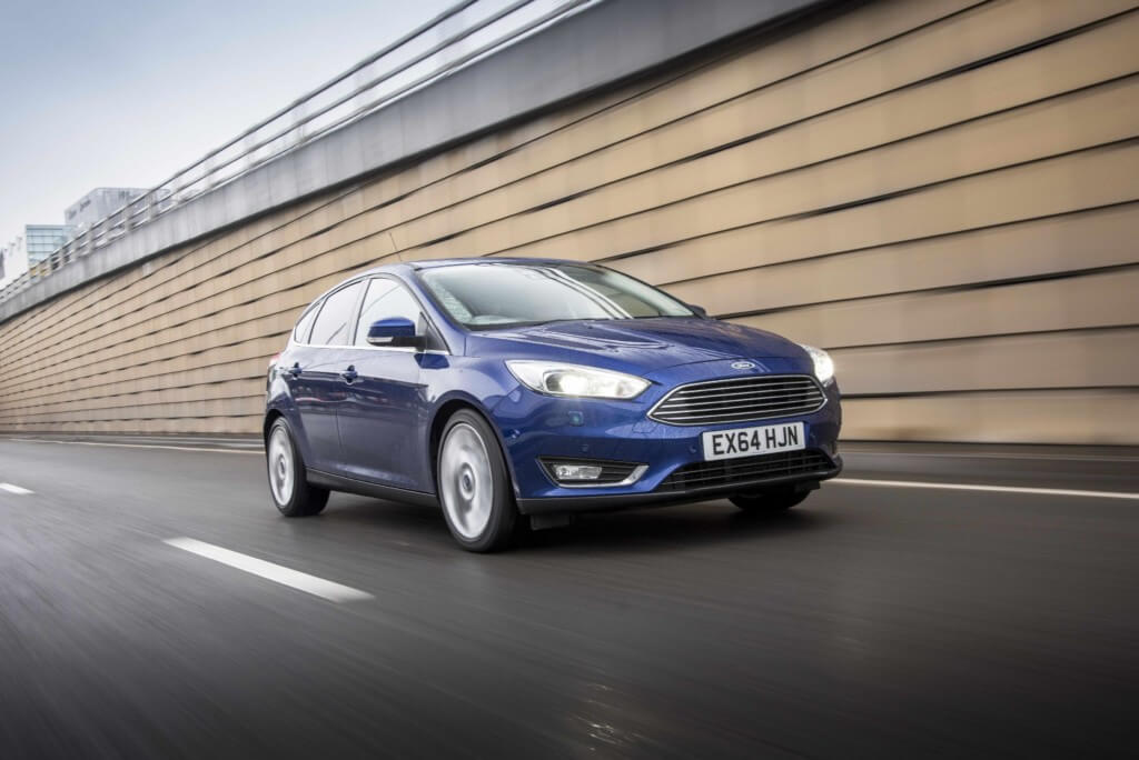 Blue Ford Focus driving down UK road