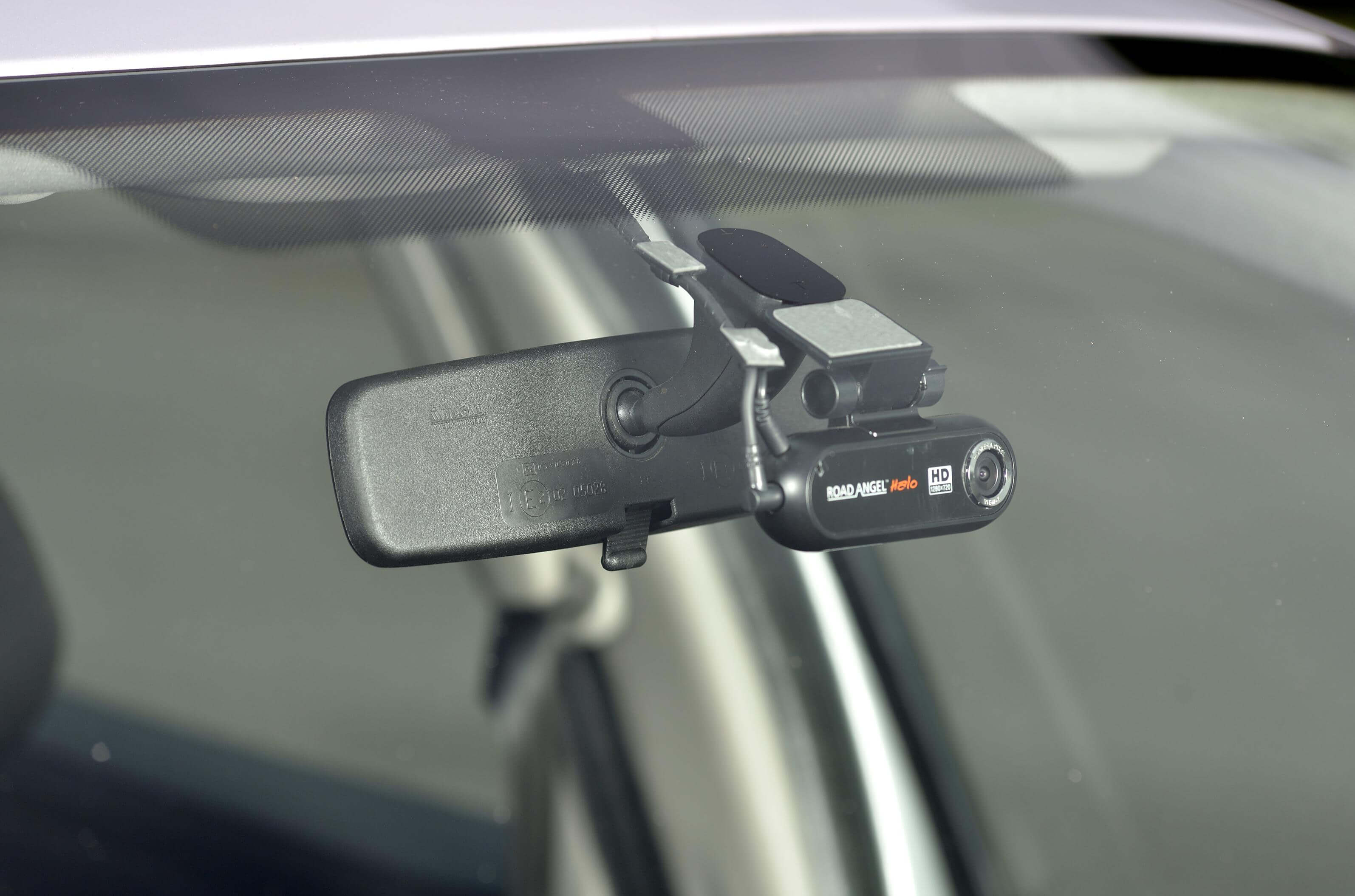 close up image of a dashcam mounted on the inside of a car windscreen