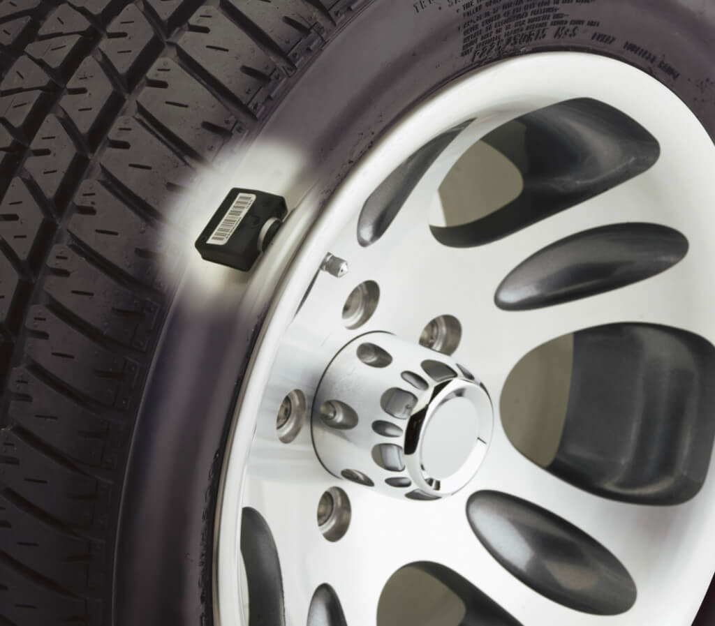 Tyre pressure monitoring system highlighted on the rim of a tyre