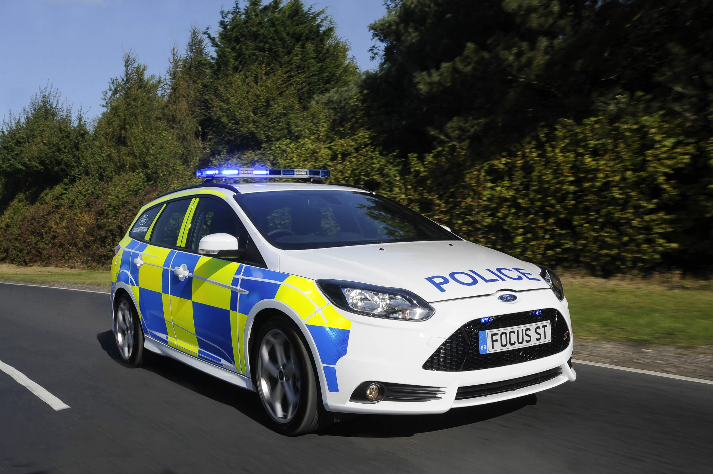 Police car patrolling looking for drivers with too many penalty points on their driving licence