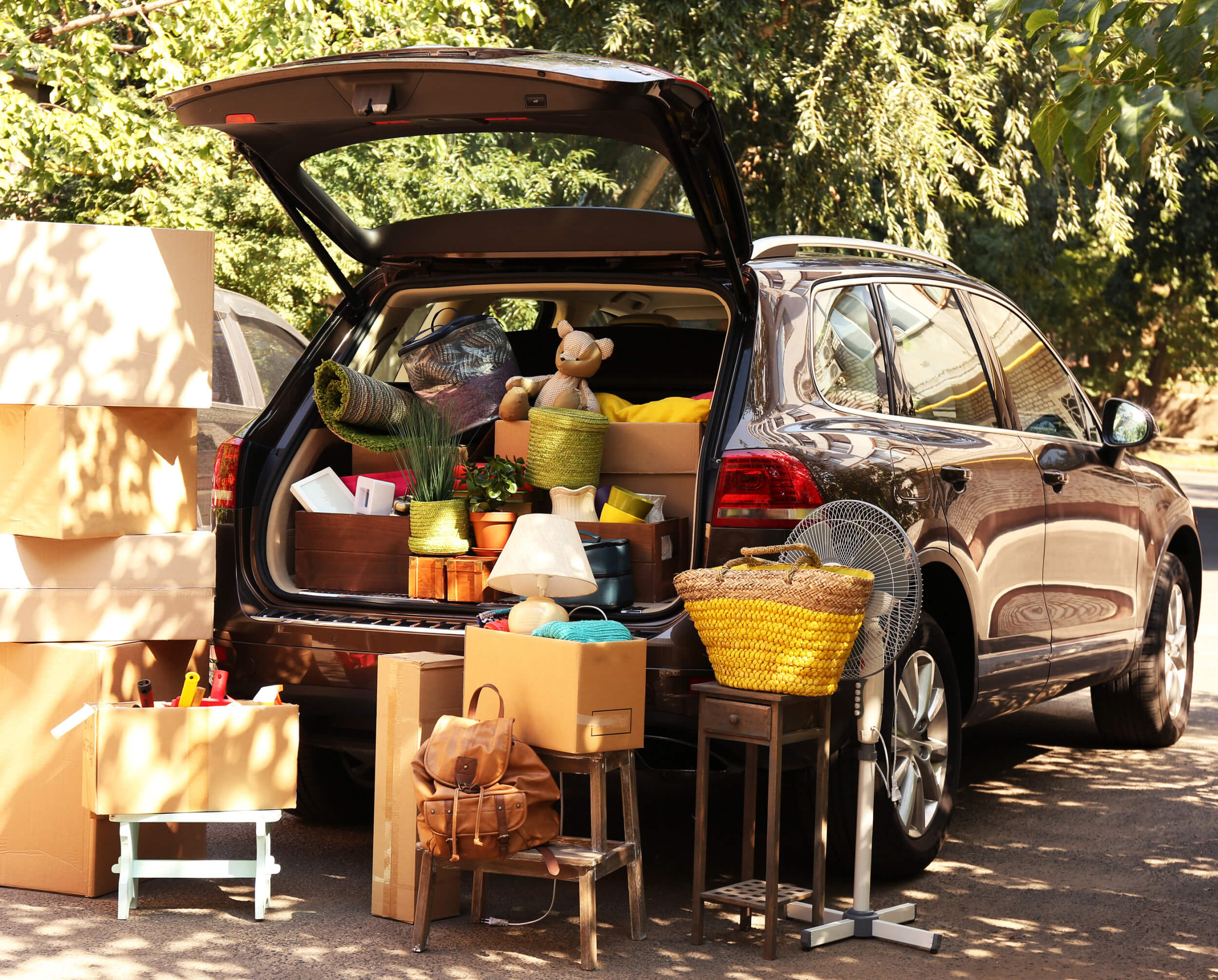 Brown SUV packed with toys, boxes and furniture which is bad for eco driving