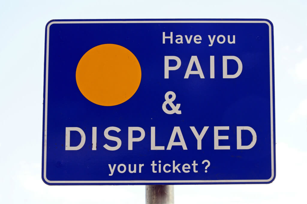 Close up of a pay and display parking sign