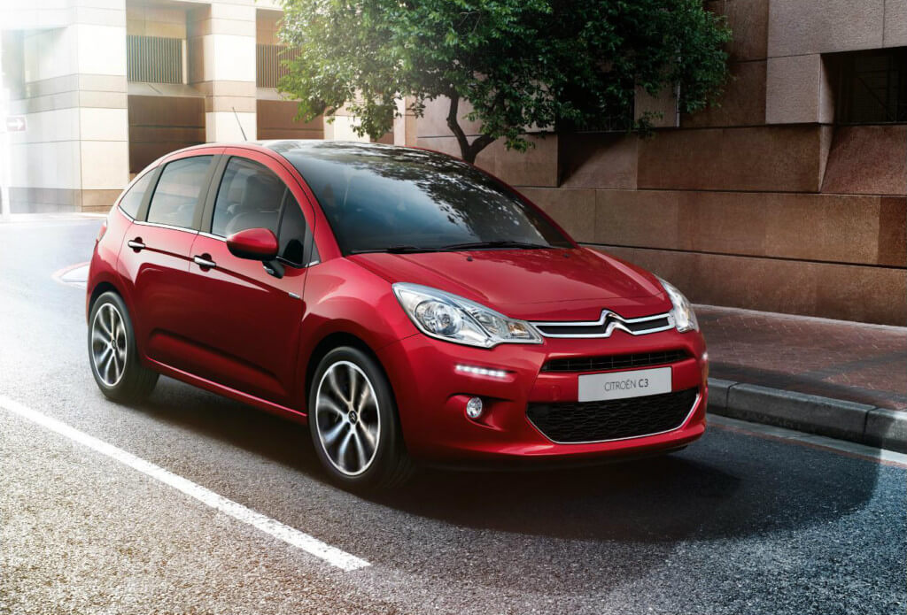 red citroen c3 parked on street