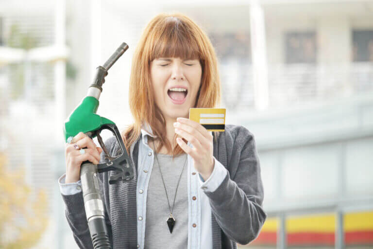 driver screaming at their credit car while filling up with fuel due to excessive costs caused by not knowing true MPG