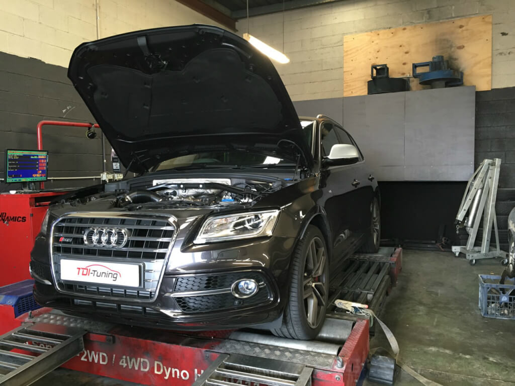 Black Audi in garage on engine tuning ramp having a power boost appointment