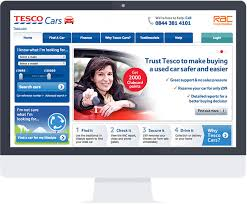 Computer screen with tesco cars website displayed. Background of web page shows smiling woman in red car leaning out of open window