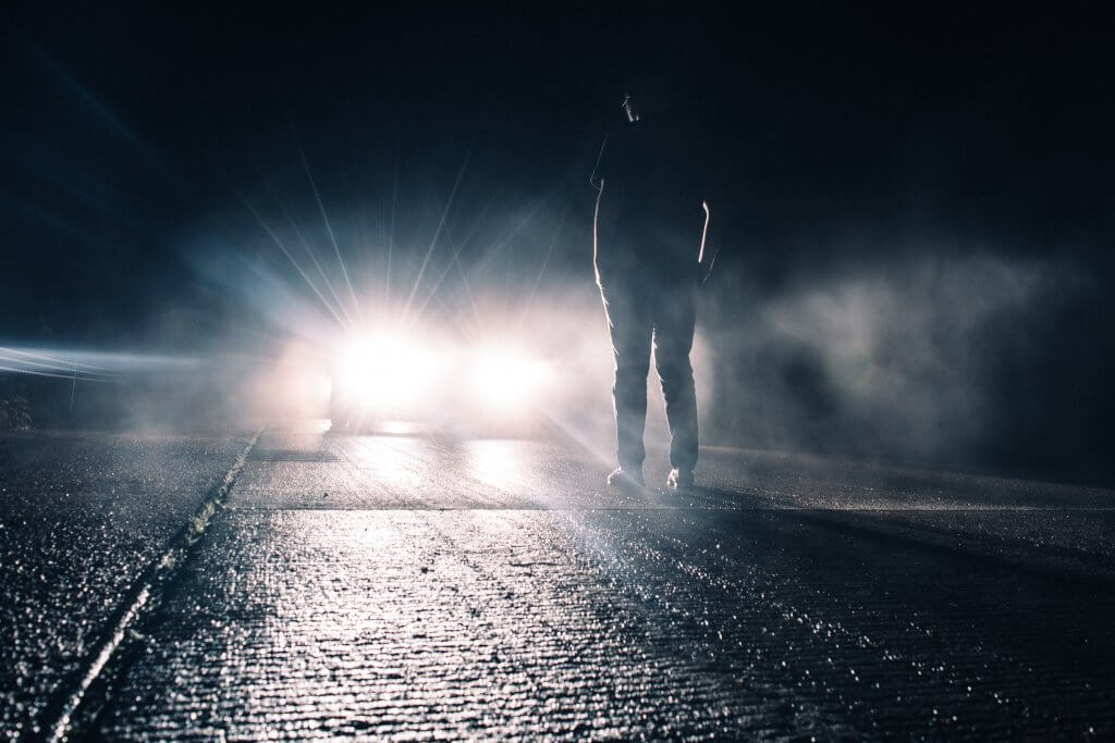 Scary man in front of a car