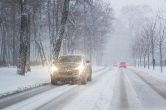 Car driving during bad winter weather