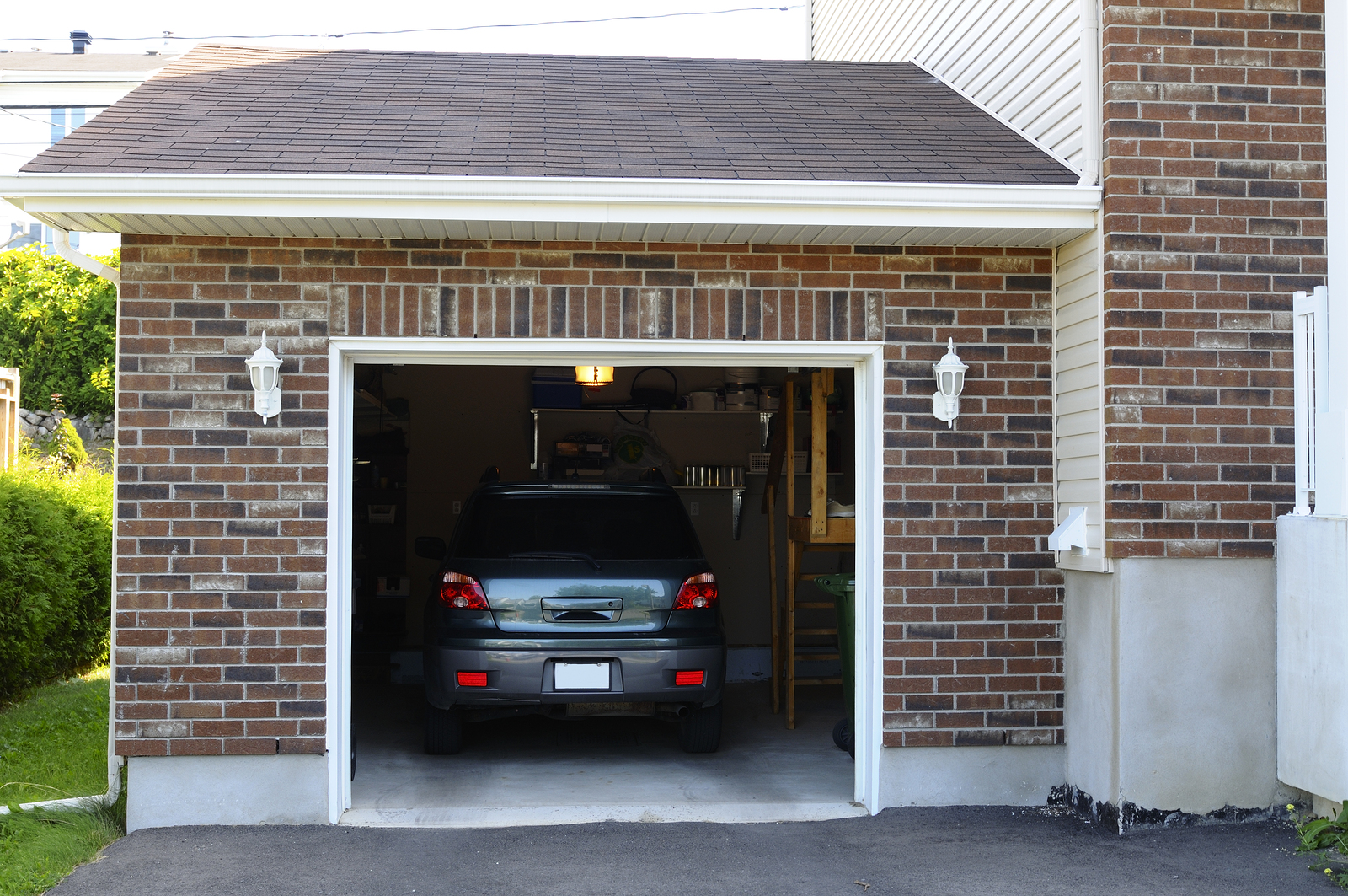 grey car stored in home garage during lockdown