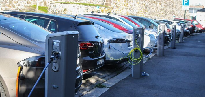 electric cars charging in a car park