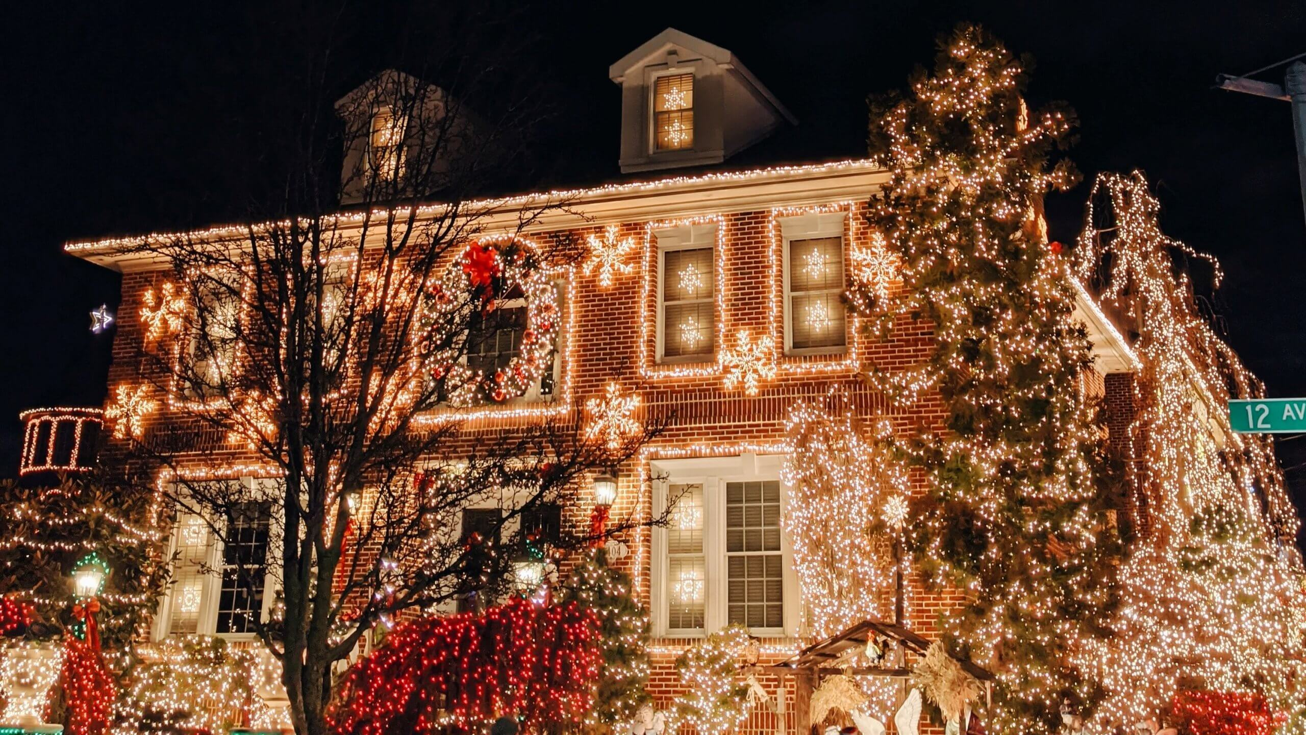 Festive christmas scene with lights on a house