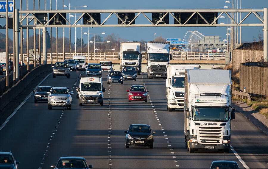 diesel cars and lorries driving on a motorway to improve DPF performance