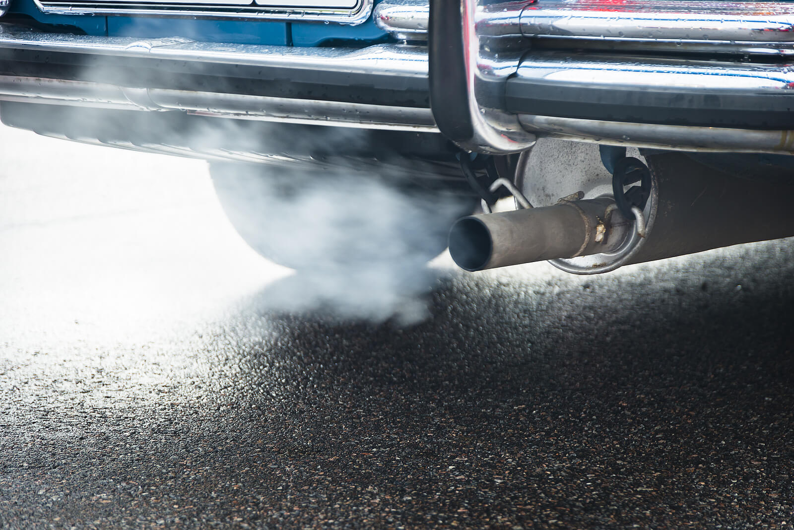 exhaust pipe with white smoke emitting exhaust emissions, reduced by AdBlue and DPF cleaning