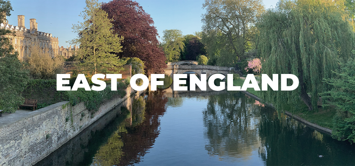 'East of England' in white text over a tree-lined river on a sunny day