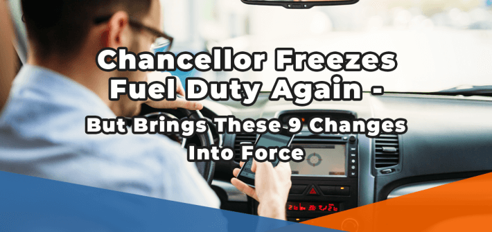chancellor freezes fuel duty again but brings these 9 changes into force in white text over the image of a man driving a car while staring at his mobile phone