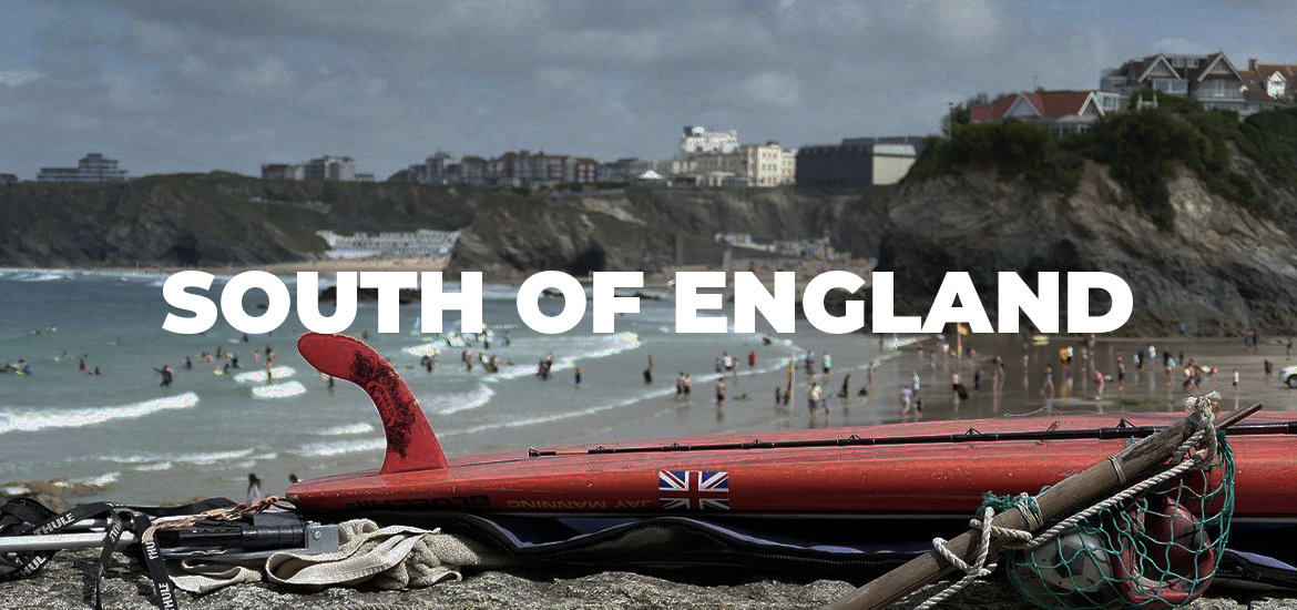 'South of England' in white text over an image of a seaside with red bodyboard in the foreground