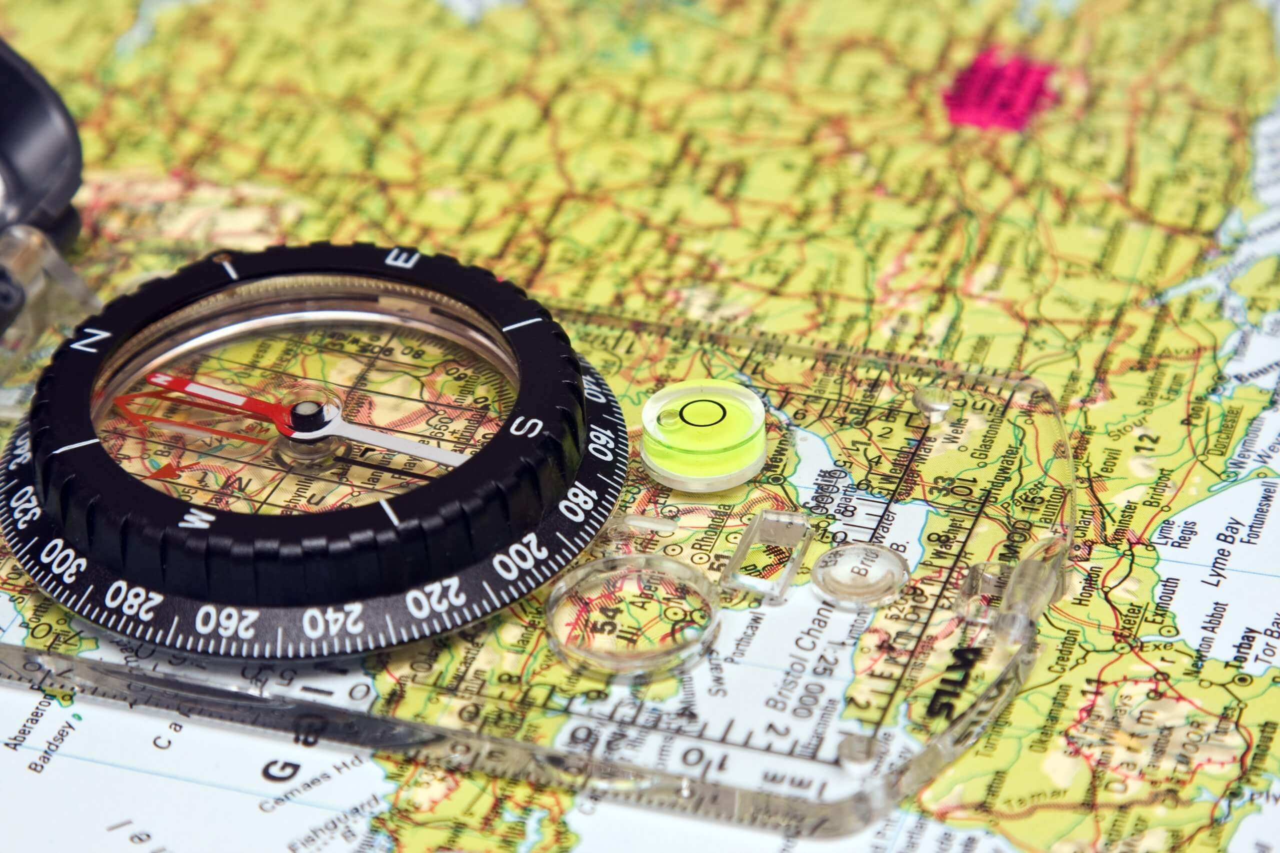 close up of compass laid on UK roadmap