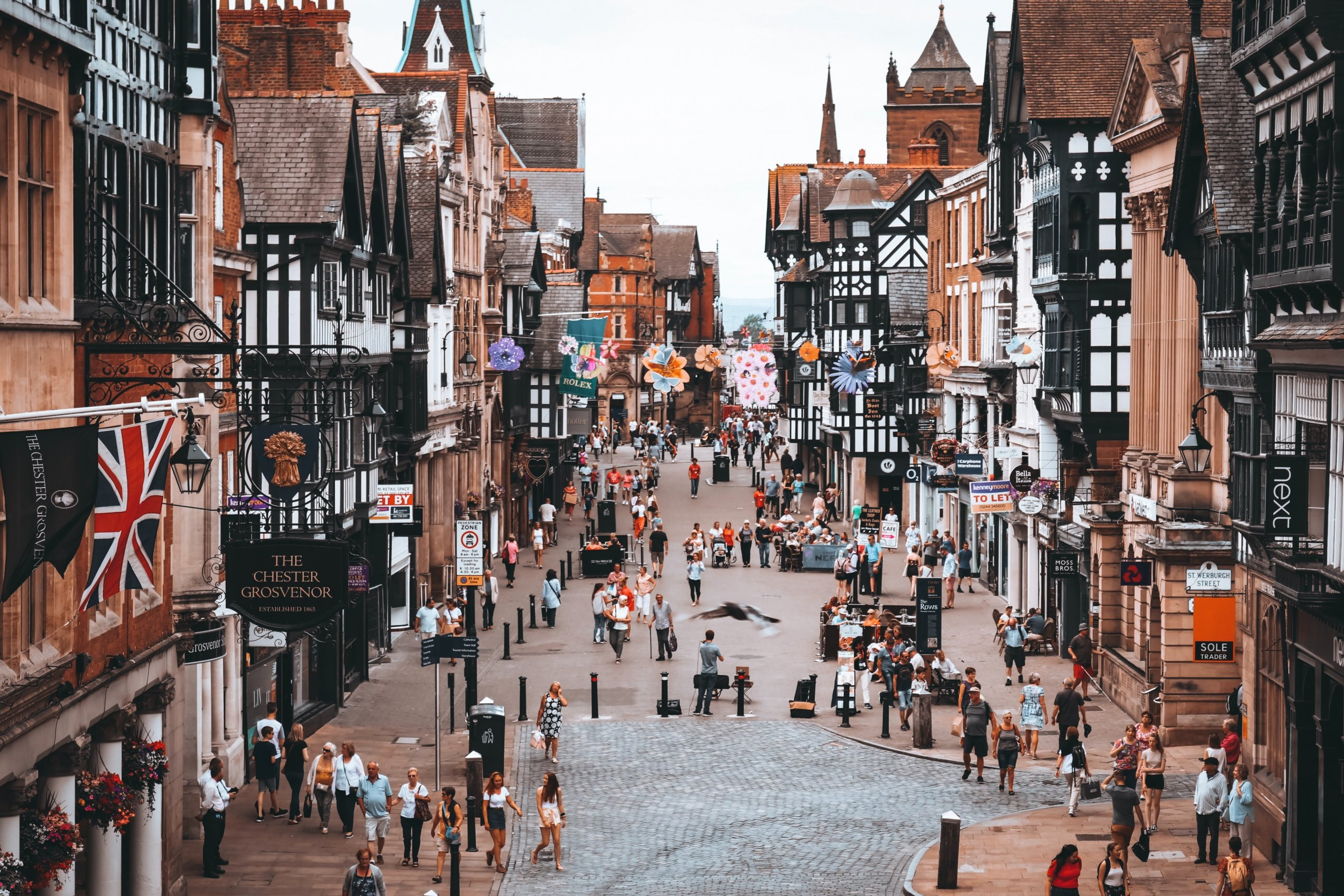 Chester city centre from above, Tudor building line cobbled street with pedestrians walking