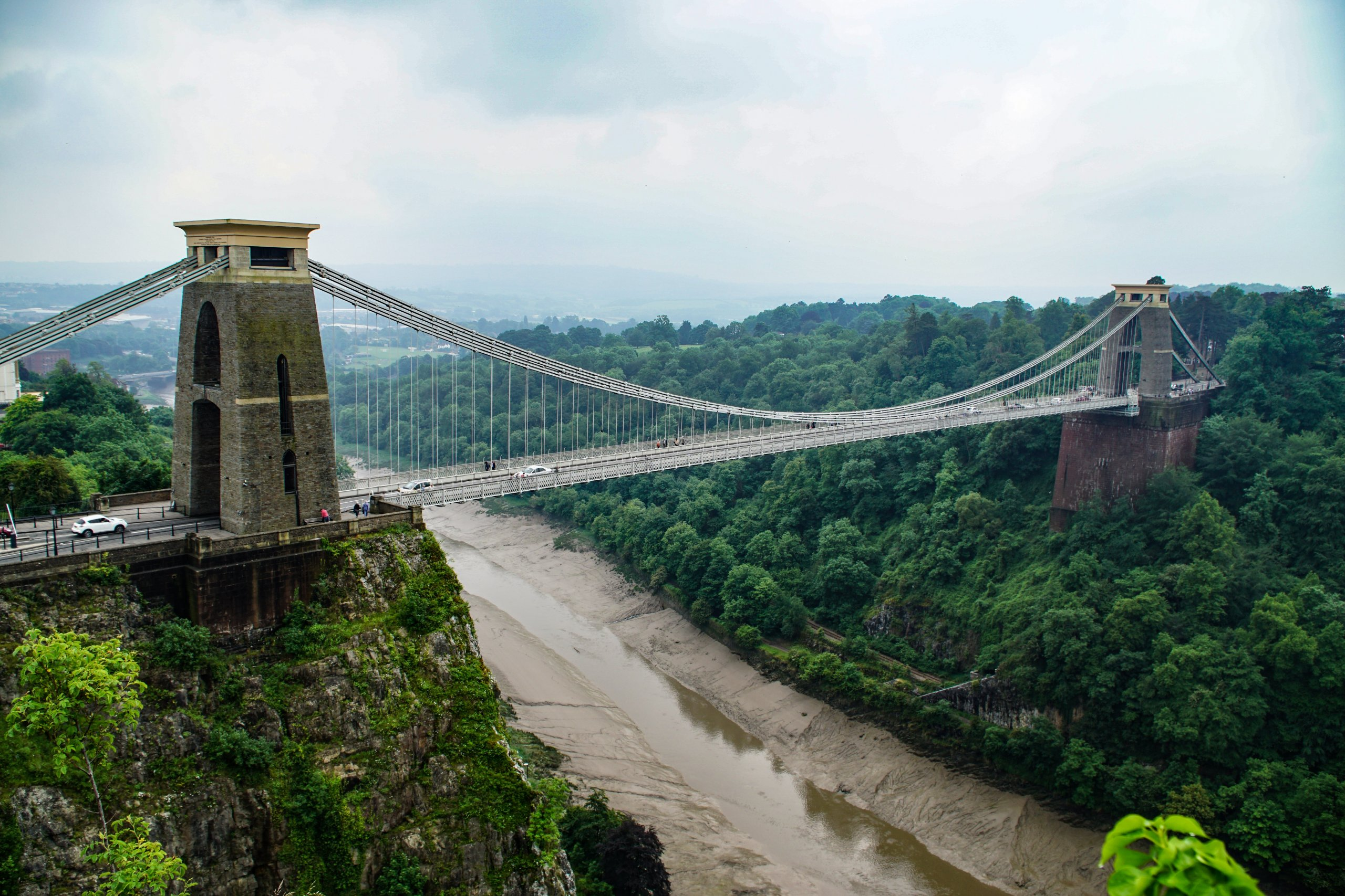 large suspension bridge crossing river and forests near Bristol, UK