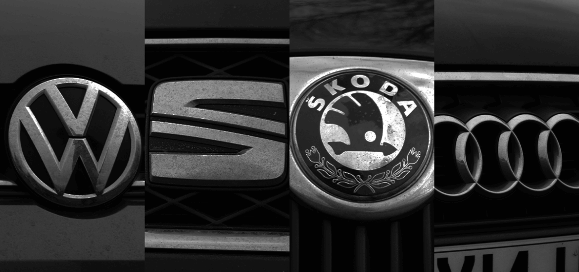 black and white image of Volkswagen, Seat, Skoda and Audi badges