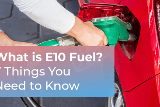 What is E10 fuel? 7 things you need to know in white text in pink and blue gradient box over the background image of a driver inserting green petrol pump into fuel tank of red car